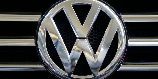 In this photo taken Feb. 14, 2013, a Volkswagen logo is seen on the grill of a Volkswagen on display...
