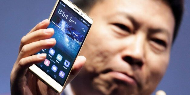 CEO of Huawei Consumer Business Group Richard Yu presents the Huawei Mate S smartphone during a company...