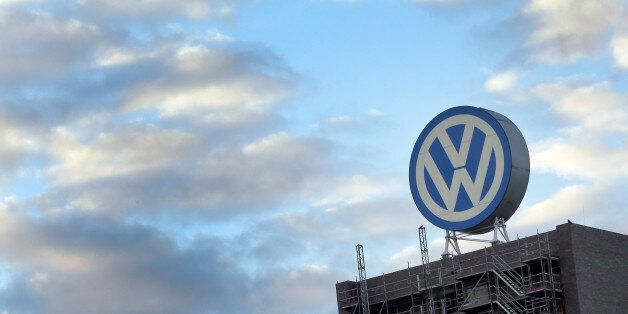 A giant logo of the German car manufacturer Volkswagen is pictured on top of a company's factory building...