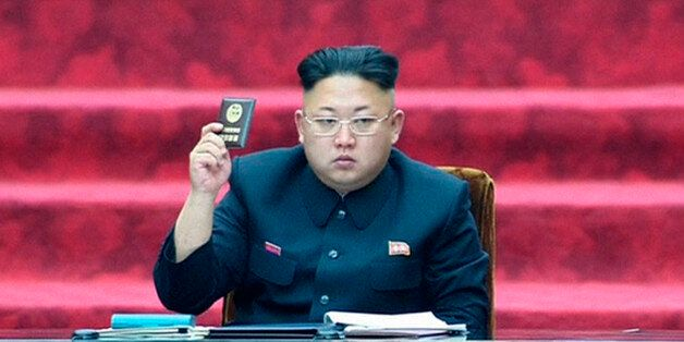 In this Wednesday, April 9, 2014 image made from video, North Korean leader Kim Jong Un holds up a parliament...