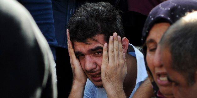 Relatives of people wounded at the explosions in Ankara, Turkey, react as they wait news for their loved...