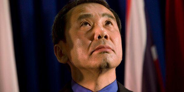 FILE - In this Feb. 15, 2009 file photo, novelist Haruki Murakami of Japan reacts before receiving the...