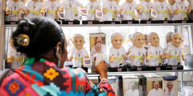 A women shops at the World Meeting of Families souvenir store ahead of Pope Francis' scheduled visit,...