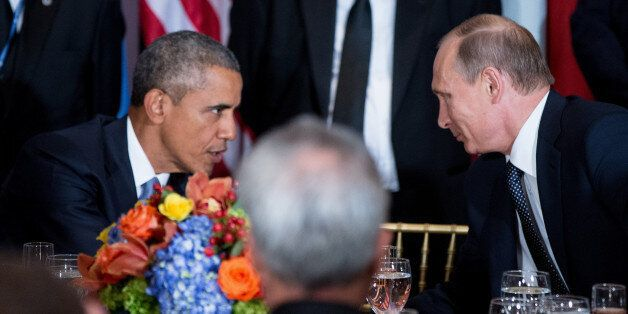 President Barack Obama and Russian President President Vladimir Putin greet each other during a luncheon,...