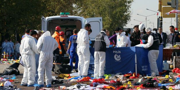 Rescue workers and police forensic officers inspect the site of an explosion in Ankara, Turkey, Saturday,...
