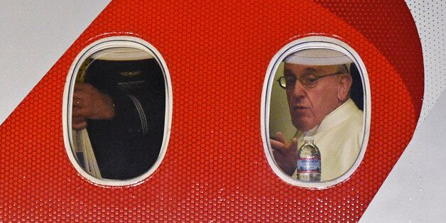 Pope Francis looks out the window a plane as he prepares to depart Philadelphia International Airport...