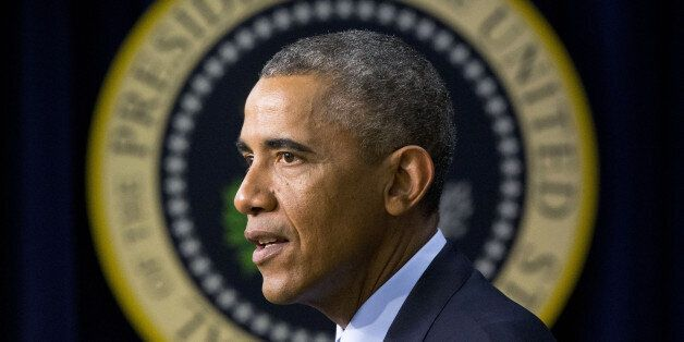 FILE - In this Friday, Sept. 26, 2014, file photo, President Barack Obama speaks in the South Court Auditorium...