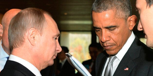 FILE _ This is a Tuesday, Nov. 11, 2014 file photo of Russian President Vladimir Putin, left, and U.S....