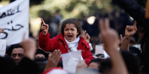 Protestors supporting the government and opposed to strikes demonstrate in Tunis, Tuesday Jan. 25, 2011....