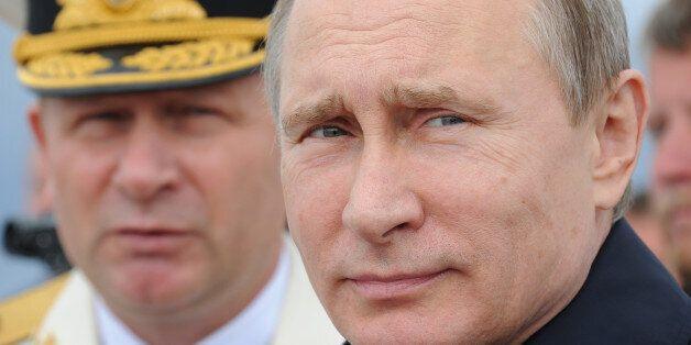 Russian President Vladimir Putin, foreground, reviews a Navy parade inBaltiisk, western Russia, Sunday,...