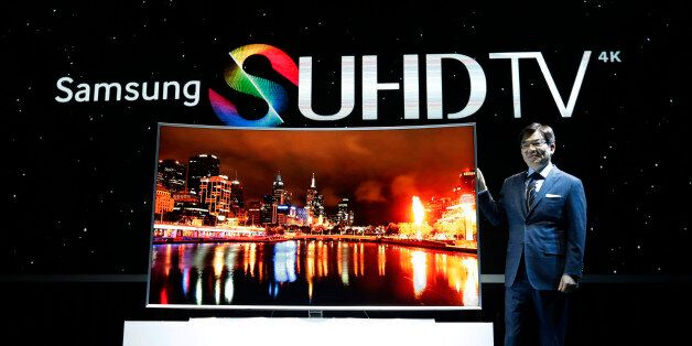 Kim Hyun-seok, head of Samsung Electronics' TV business, poses with its SUHD 4K TV during a press conference...