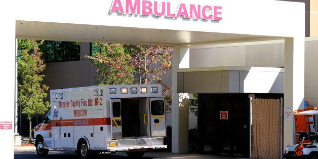 An ambulance sits outside of Mercy Medical Hospital where victims were taken following a deadly shooting...