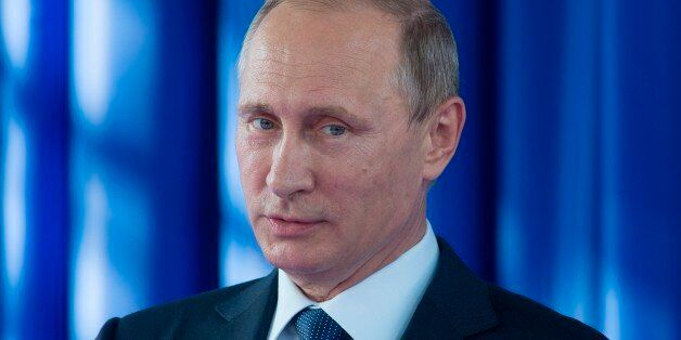 Russian President Vladimir Putin attends a launching ceremony of a technical tunnel of the Sheskharis...