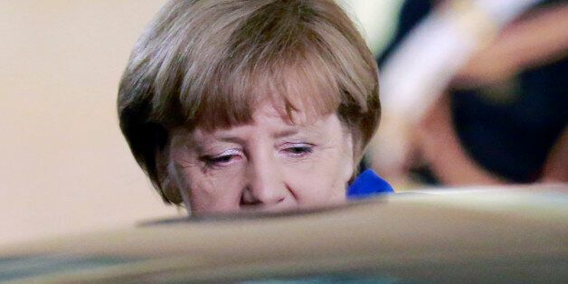German Chancellor Angela Merkel leaves the Elysee Palace in Paris, France, after a a joint press conference...