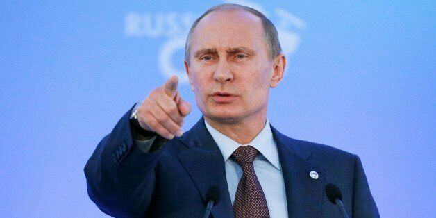 Russia's President Vladimir Putin speaks during a media conference after a G-20 summit in St. Petersburg,...