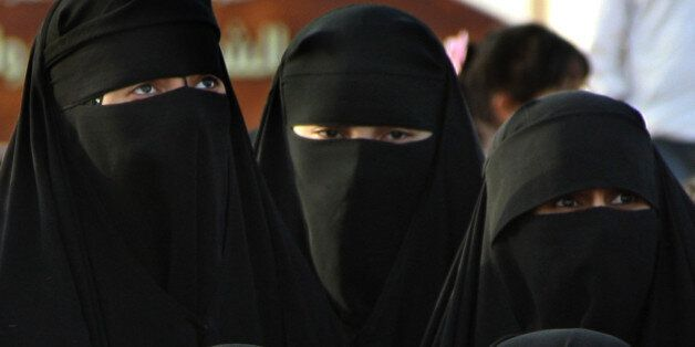 FILE - In this Thursday, April 1, 2010 file photo, Saudi women attend the traditional Arda dance, or...