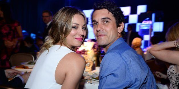 Kaley Cuoco, left, and Ryan Sweeting pose in the audience at the 22nd