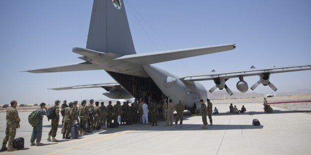 In this Tuesday, Aug. 18, 2015 photo, Afghan National Army soldiers line up to get into a C-130 Hercules,...