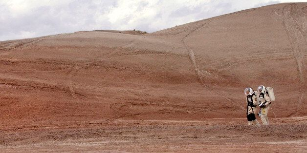 Crew commander Gus Frederick and Greg Drayer, left, explore the terrain outside the Mars Desert Research...