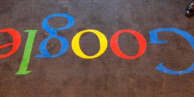 FILE - In this Dec.6, 2011 file photo, the Google logo is seen on the carpet at Google France offices...