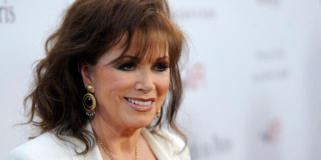 Jackie Collins poses at a screening of the