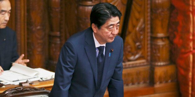 Japanese Prime Minister Shinzo Abe acknowledges after a censure motion against him filed by an opposition...