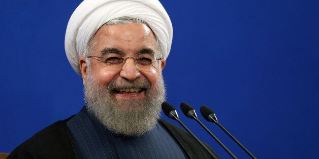 FILE - In this Aug. 29, 2015 file photo, Iran's President Hassan Rouhani smiles during his press conference...