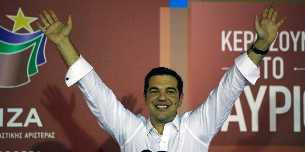 Alexis Tsipras the leader of left-wing Syriza party waves to his supporters after the election results...