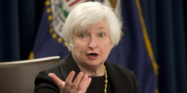 Federal Reserve Chair Janet Yellen answers questions during a news conference in Washington, Thursday,...