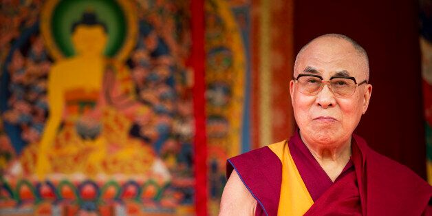 Tibet's exiled government and Buddhist spiritual leader the Dalai Lama stands on stage before making...