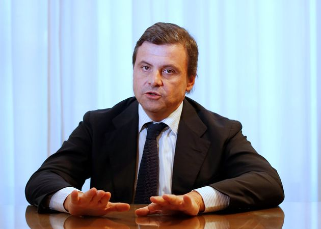 Italian Industry Minister Carlo Calenda gestures as he talks during an interview with Reuters in his...