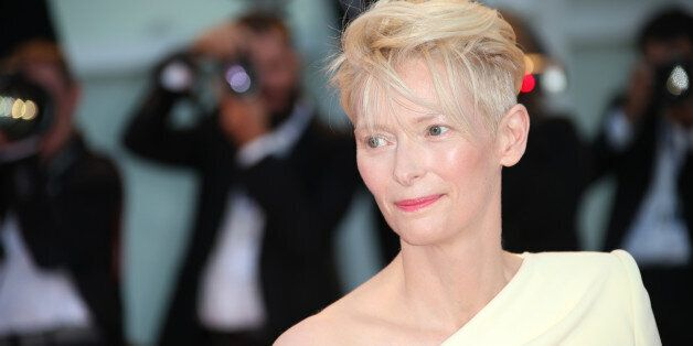 Tilda Swinton poses for photographers at the premiere of the film A Bigger Splash during the 72nd edition...