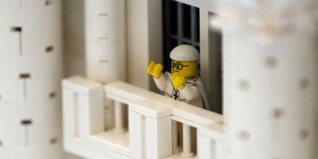 In this Friday, Sept. 11, 2015 photo, shown a Lego pope figure on a balcony overlooking the crowd in...