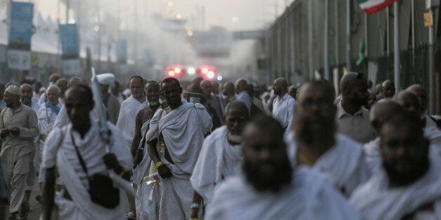 Pilgrims walk by the site where pilgrims were crushed and trampled to death during the annual hajj pilgrimage...