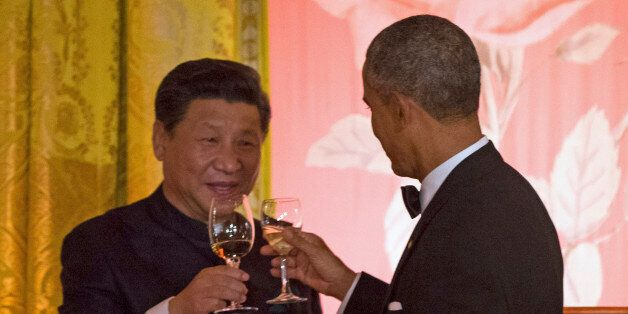 President Barack Obama and Chinese President Xi Jinping arrive for their joint news conference, Friday,...