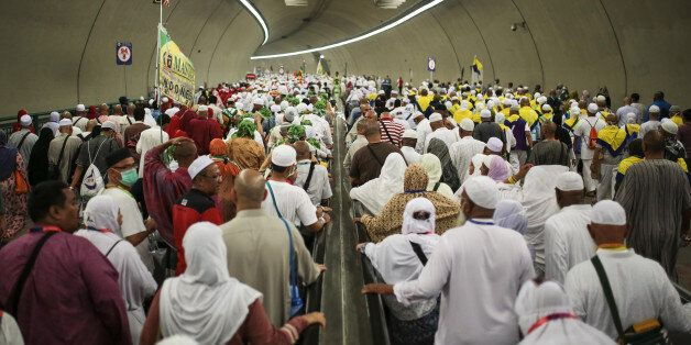 Muslim pilgrims walk in a tunnel on their way to cast stones at Jamarrat pillars, a ritual that symbolises...