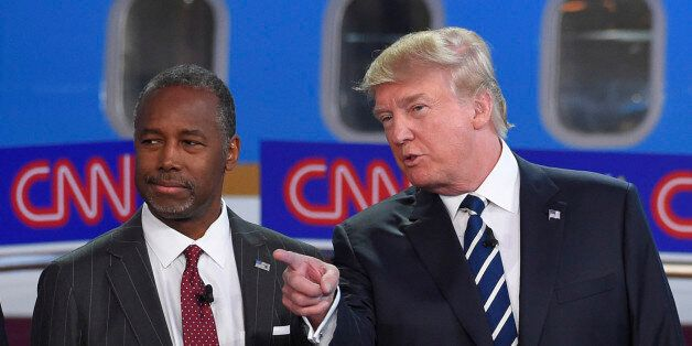 Republican presidential candidates Ben Carson, left, and Donald Trump talk before the start of the CNN...