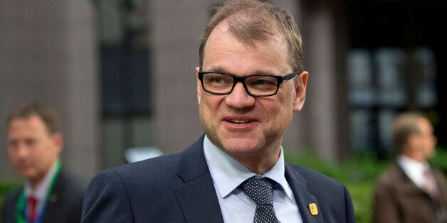 FILE - In this Monday, June 22, 2015 file photo, Finnish Prime Minister Juha Sipila, center, arrives...
