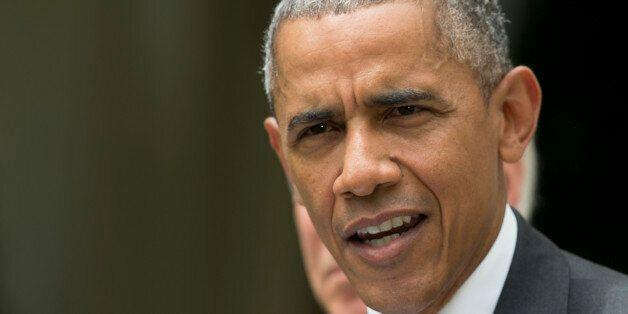 President Barack Obama, accompanied by Vice President Joe Biden, speaks in the Rose Garden of the White...