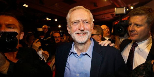 Jeremy Corbyn smiles as he leaves the stage after he is announced as the new leader of The Labour Party...