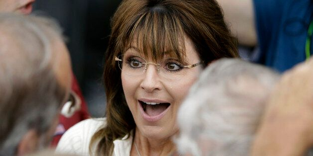 Former Alaska Gov. Sarah Palin greets supporters after speaking to Tea Party members during the Restoring...