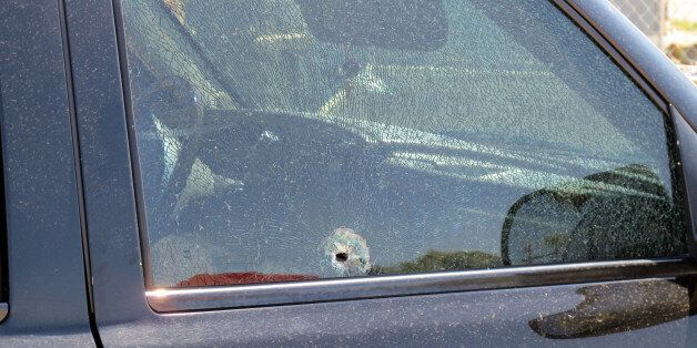 This Saturday, Aug. 29, 2015 photo provided by The Arizona Department of Public Safety shows a SUV window...