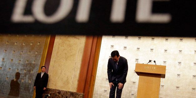 FILE - In this Tuesday, Aug. 11, 2015 file photo, Lotte group Chairman Shin Dong-bin bows after he issued...