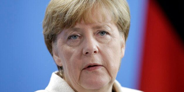 German Chancellor Angela Merkel addresses the media during a joint press conference with the Prime Minister...