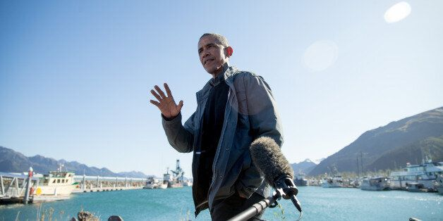 President Barack Obama speaks to reporters before taking a boat tour at the Kenai Fjords National Park,...