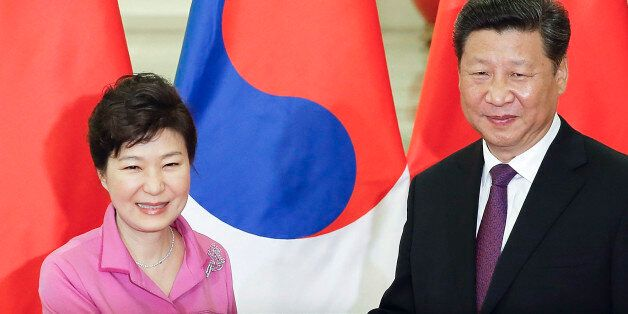Chinese President Xi Jinping, right, shakes hands with South Korean President Park Geun-hye at the Great...