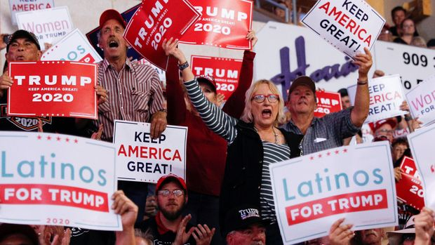 Members of the audience look on as U.S. President Donald Trump delivers remarks at a Keep America Great rally at the Santa Ana Star Center in Rio Rancho, New Mexico, on September 16, 2019.  REUTERS/ Tom Brenner