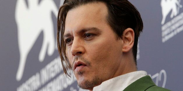 Actor Johnny Deep poses during the photo call for the movie Black Mass at the 72nd edition of the Venice...