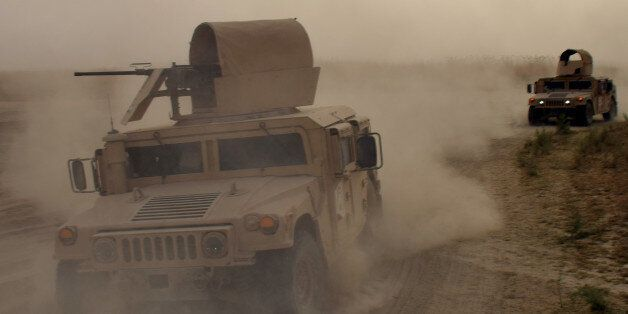 In this Saturday, Sept, 12, 2015 photo, Iraqi army Humvees arrive to support security forces and Sunni...