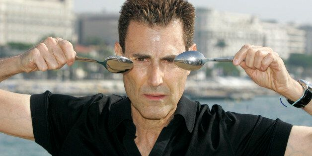Israeli-British illusionist Uri Geller poses during the 24th MIPCOM (International Film and Program Market...